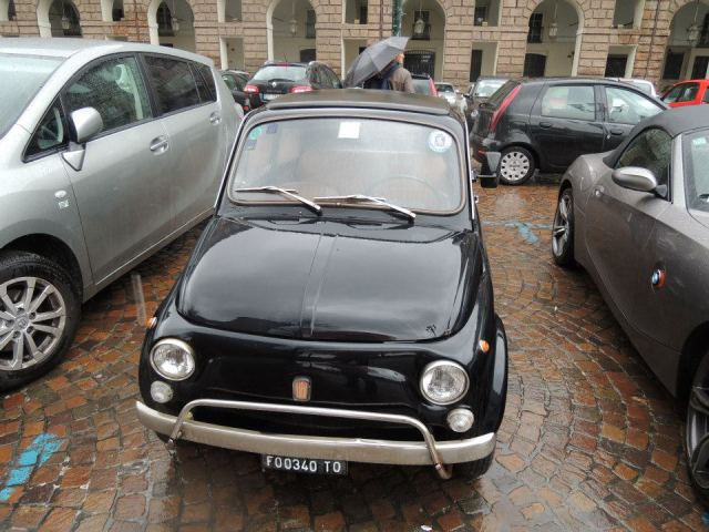 An old Fiat 500 on the streets of Turin